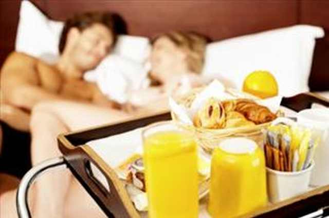 developing a more romantic soul: couple enjoying breakfast in bed