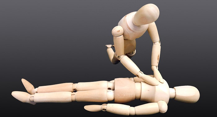 Household Injuries - Wooden puppets doing CPR