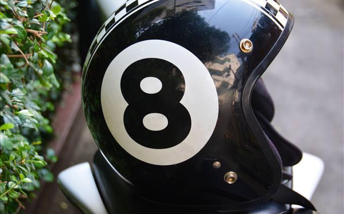 crash helmet with number '8' on it