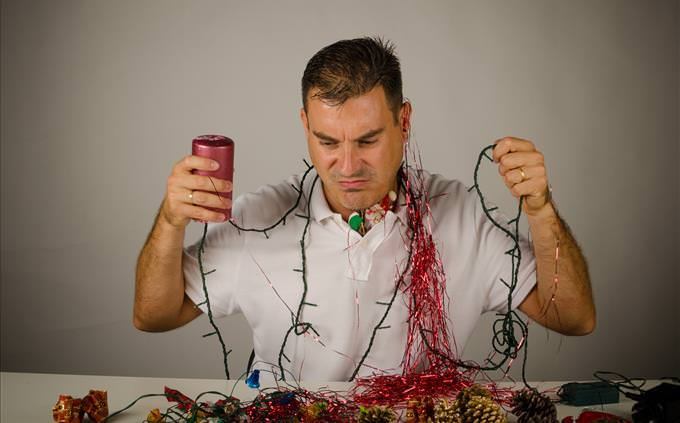 Frustrated man with Christmas decorations