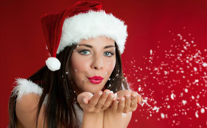 festive woman blowing a kiss