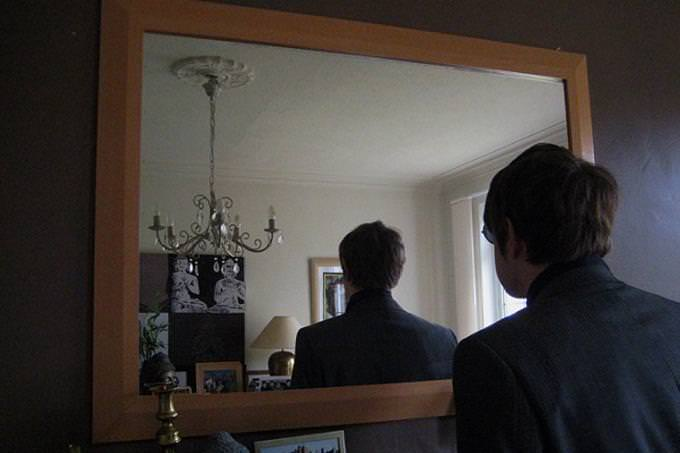 a man looking in  mirror