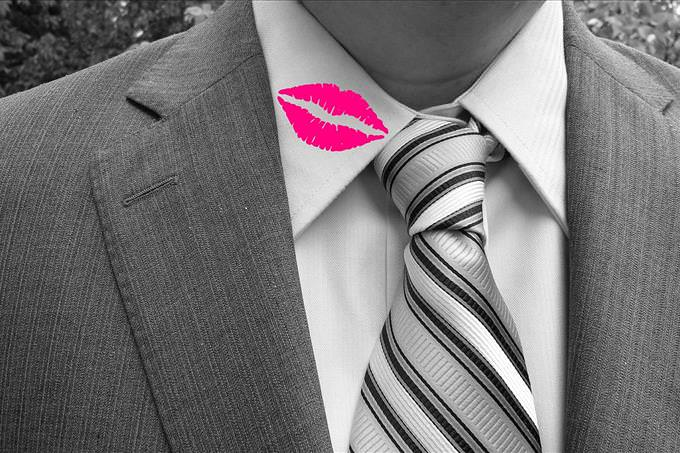 man with lipstick on collar