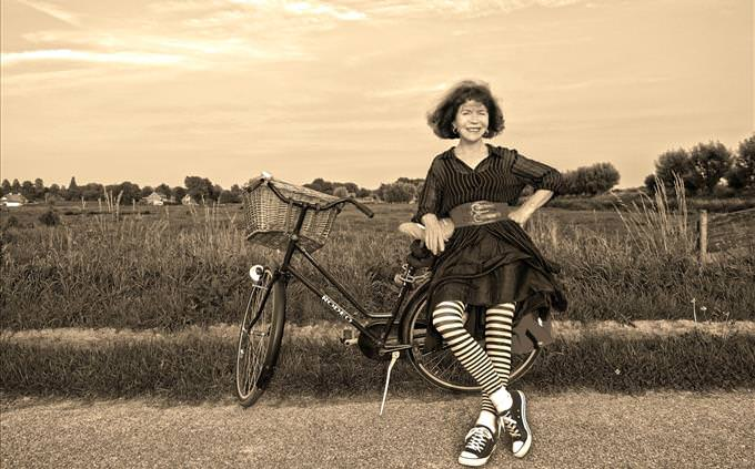 vintage photo of girl with bicycle