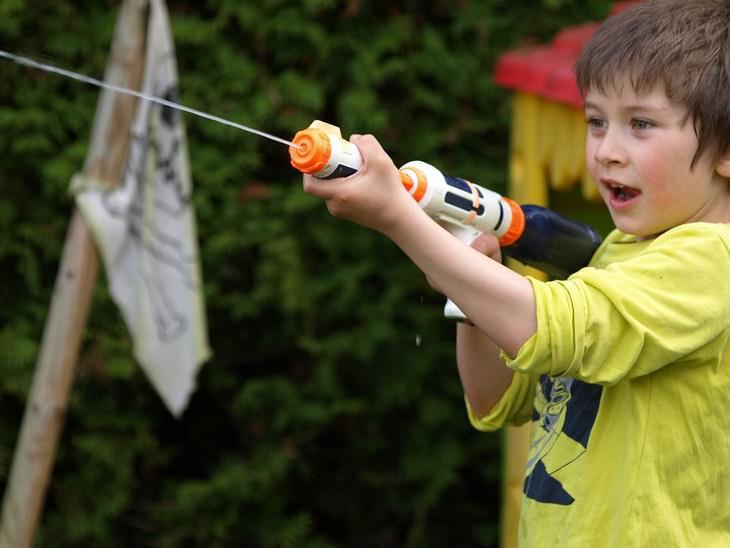 boy shooting water gun