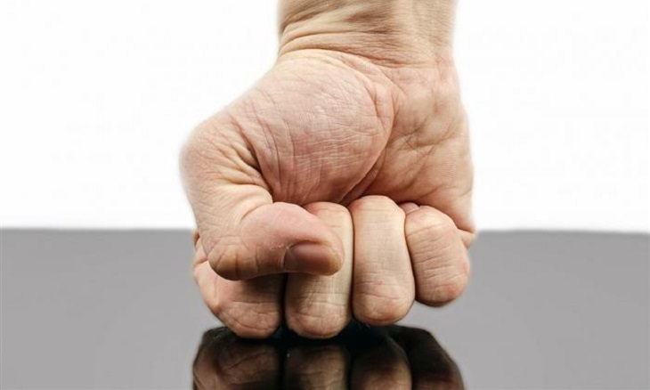 fist on table