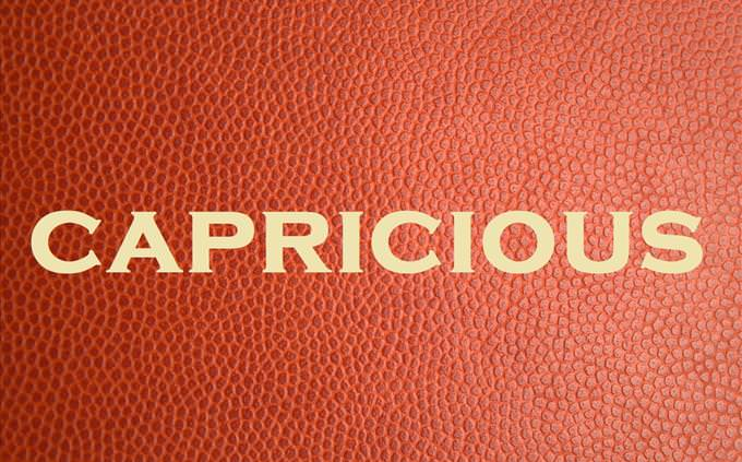 'capricious' on red leather background