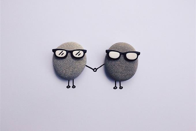 Two pebbles with sunglasses