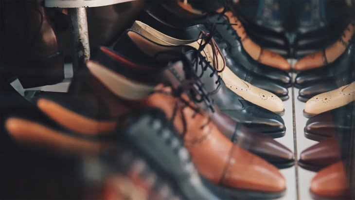 mens leather shoes lined up in rows