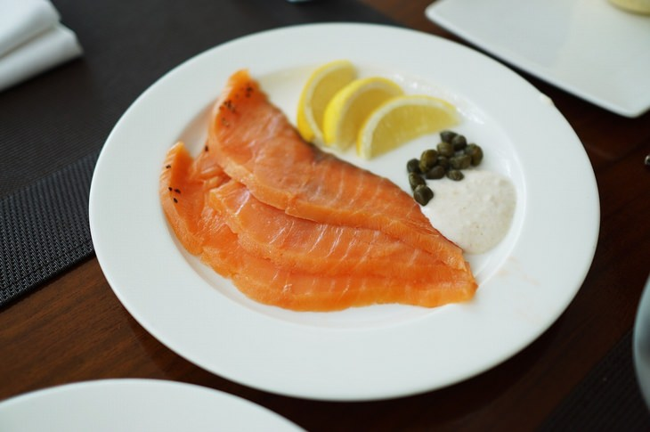 sliced smoked salmon on a plate