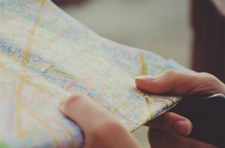 habits: mans hand holding a map