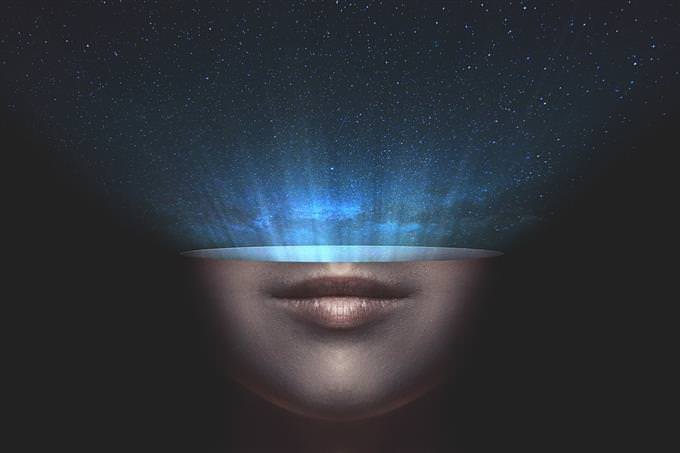 Graphic illustration of the lower half of a face with a starry sky coming out of it