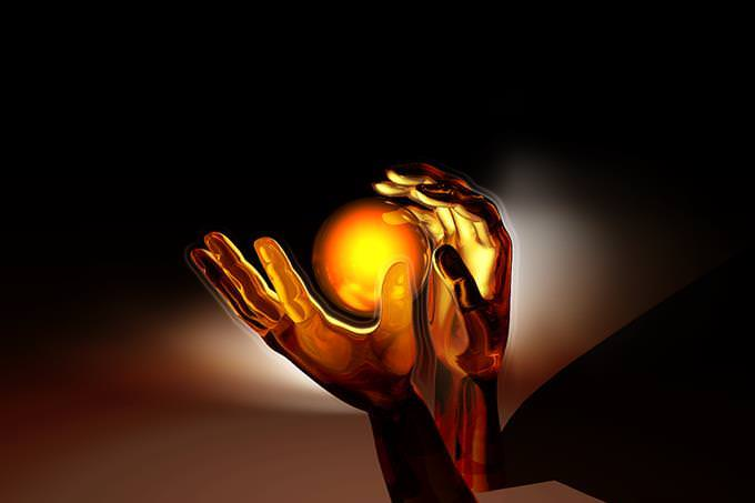 Picture of a ball of light floating between two hands