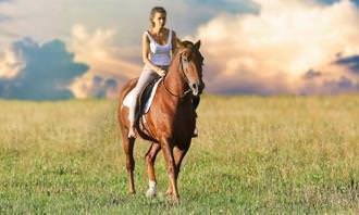 A woman riding a horse