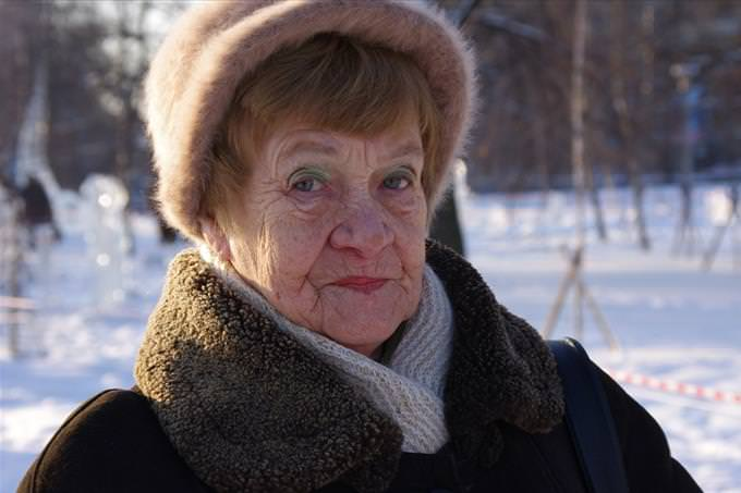 elderly lady in the snow