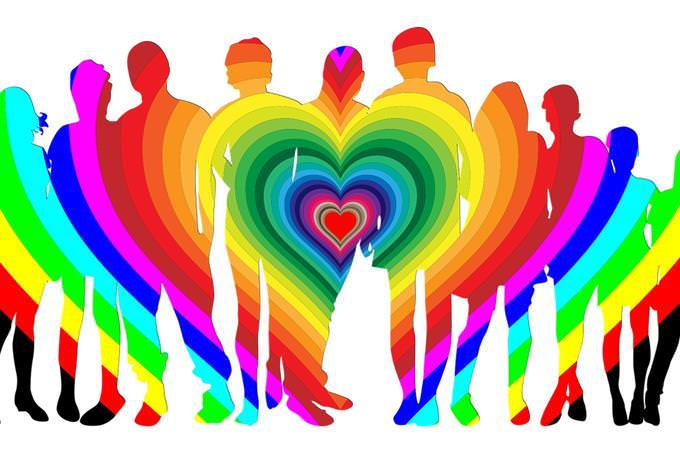 Illustration of a family with a heart in different colors