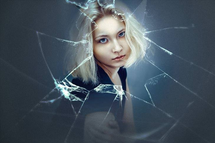 common dreams blond woman in front of a broken glass