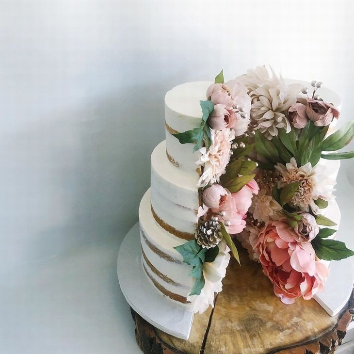 cakes by Darsi split cake with flowers