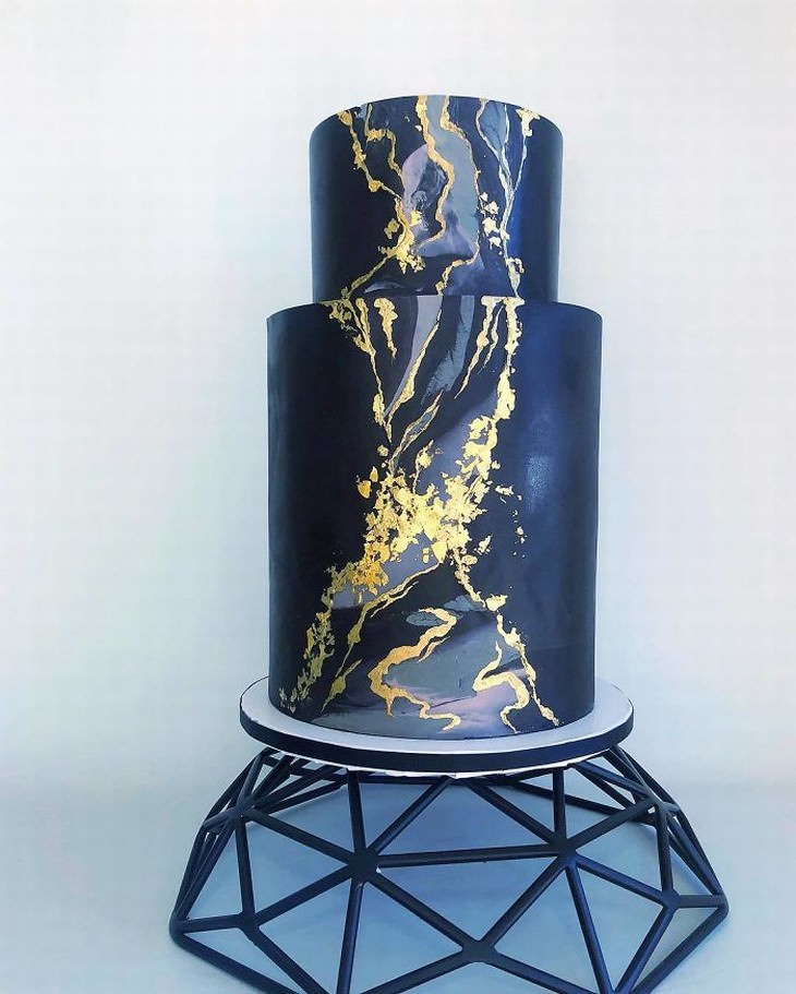 cakes by Darsi gold and dark blue