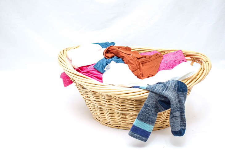 Organization Hacks to Declutter Your Closet basket with clothes