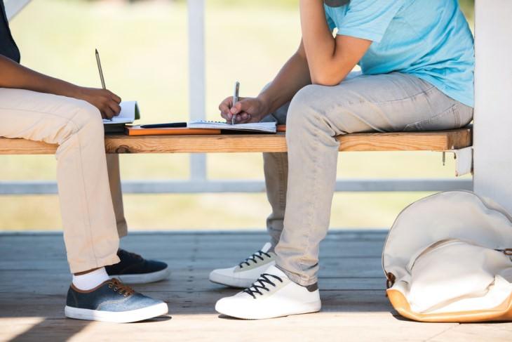 joke: teen boys sitting on bench