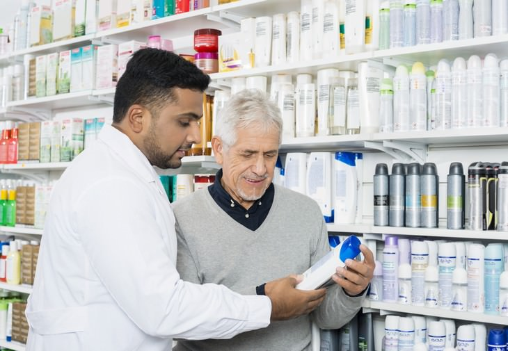 sulfates pharmacist helping man select a shampoo