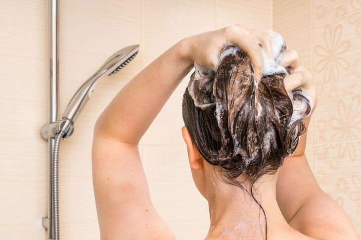 bad habits for skin and hair woman shampooing hair