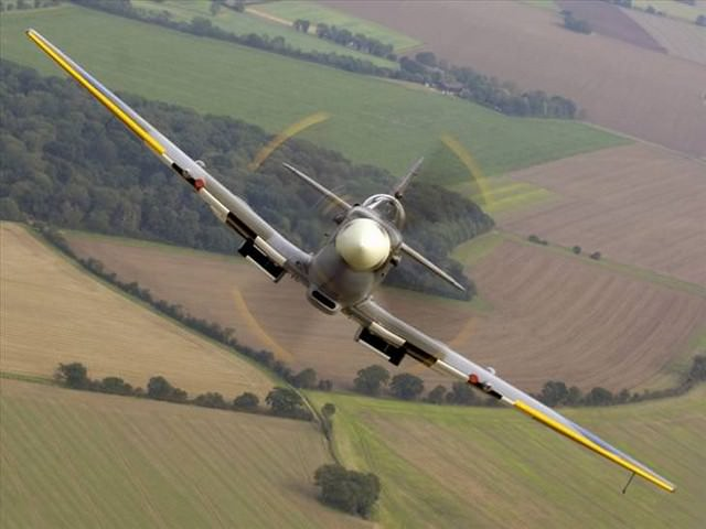award winning photos: airplane over a field