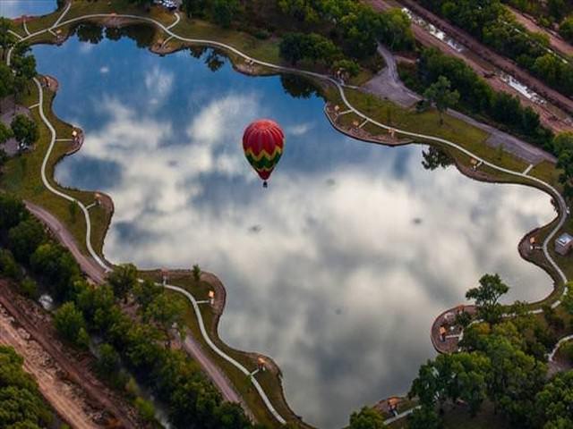 award winning photos: hot balloon over a lake