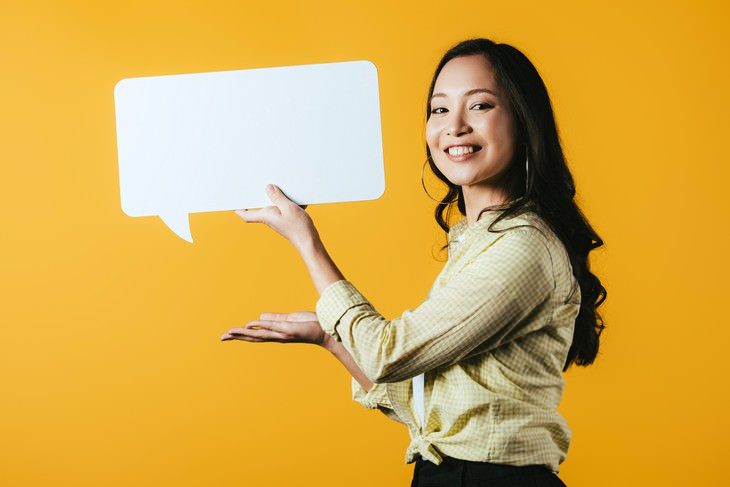 weird beneficial habits woman holding up a thought bubble
