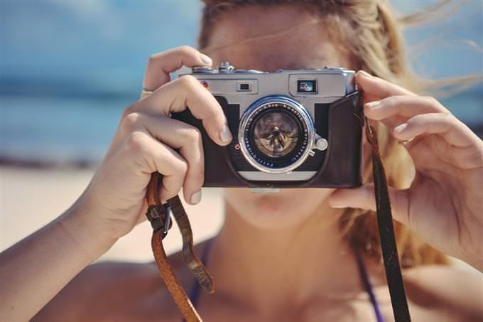 smile test: woman taking a photo