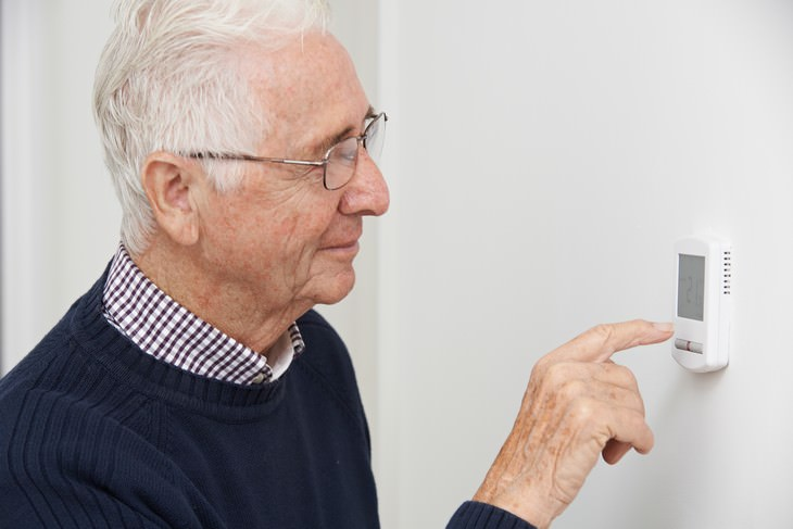 Habits Bad for Eyes man using the thermostat