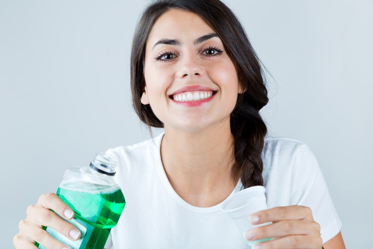 mouthwash dangers woman smiling after using mouthwash