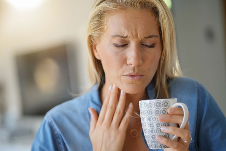 rose water woman in pain with cup touching throat with hand