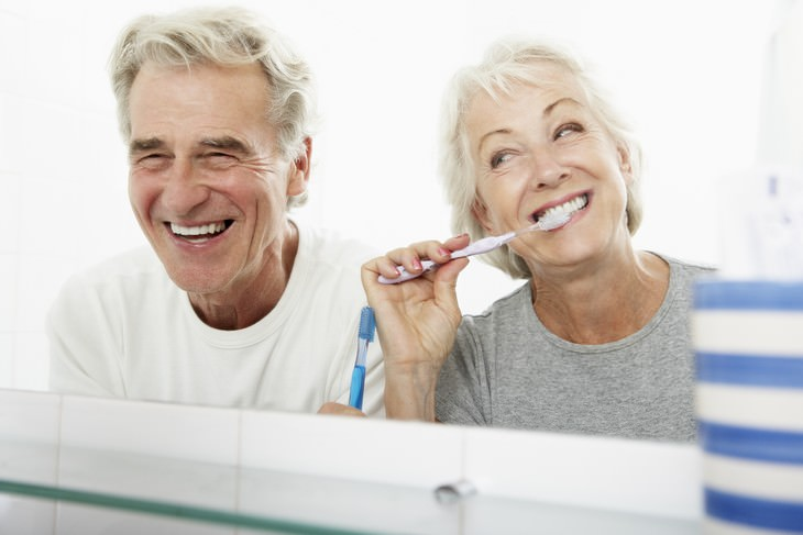 Alzheimer's and Gingivitis study senior couple brushing teeth