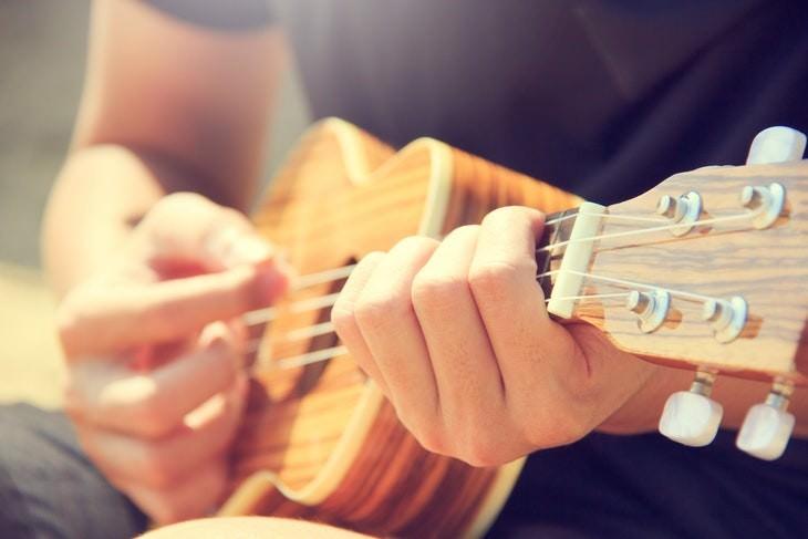 depression myths man playing the ukulele