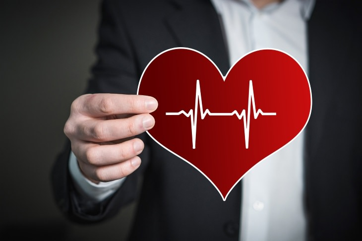 hypertension bad or not man holding a heart