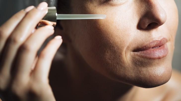 misleading skincare marketing claims woman applying serum