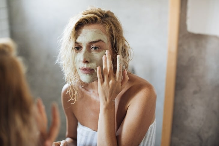 misleading skincare marketing claims woman applying a mask