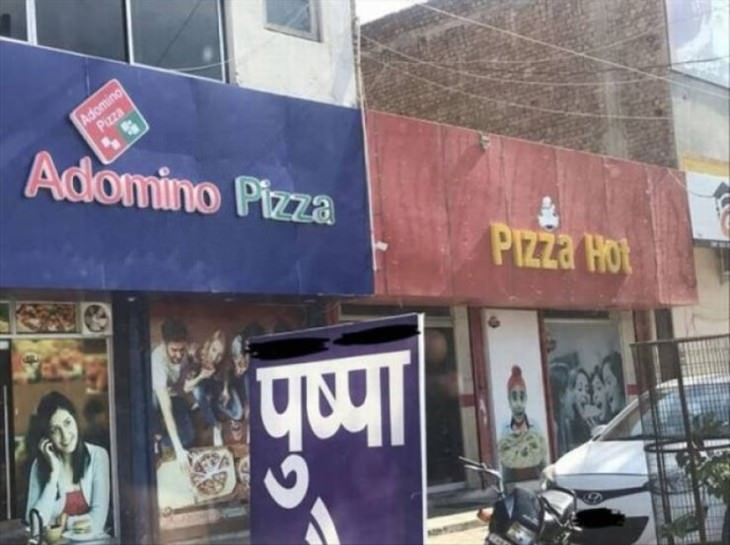 funny street signs adomino and pizza hot