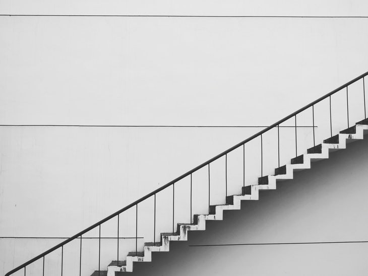 tips to get out of bed black and white staircase