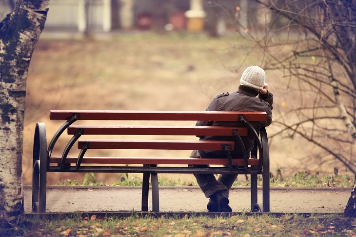 Lonely Millennials: alone on bench