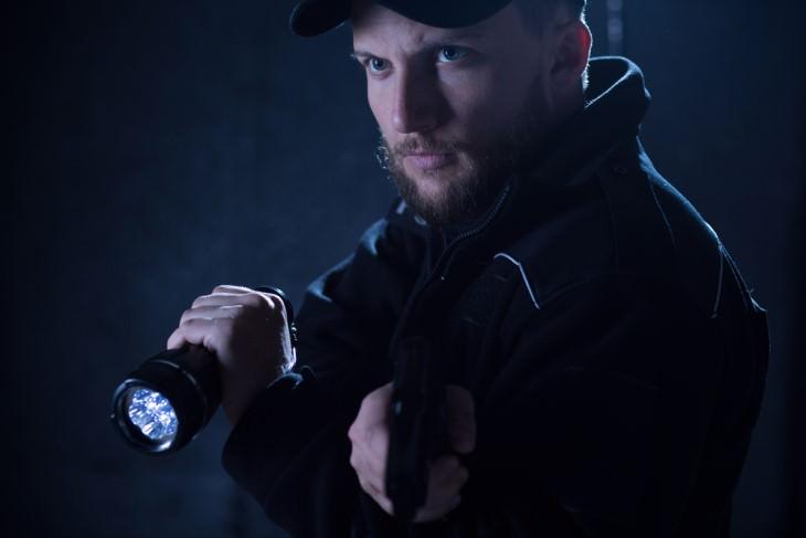 joke cop with flashlight