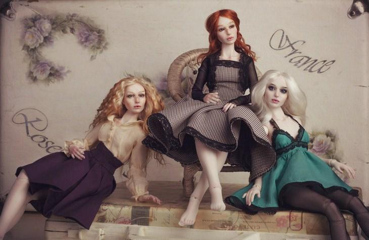 Porcelain dolls: three dolls classy
