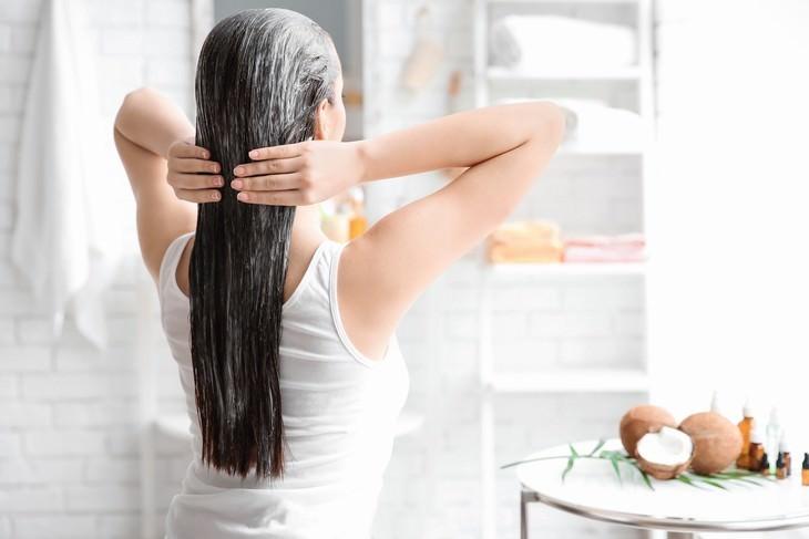 scalp masks woman applying hair mask