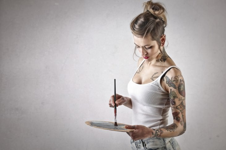joke: tattoo artist holding paint brush