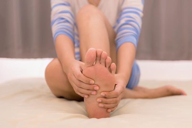 night leg cramps woman massaging foot