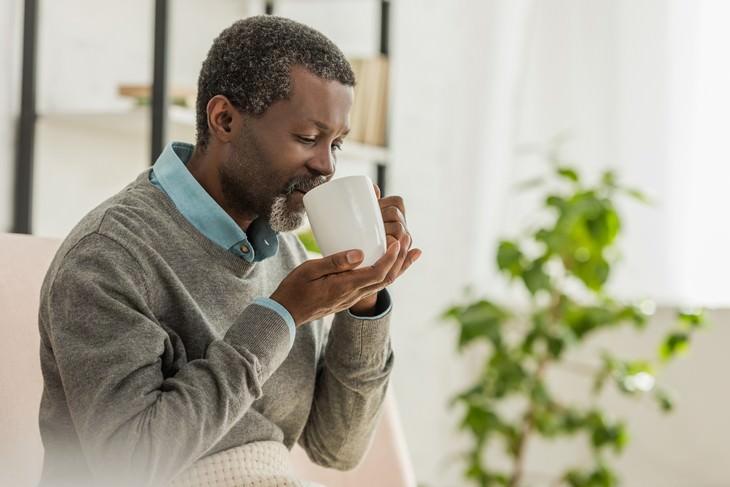 green tea and cardiovascular health elderly man drinking tea