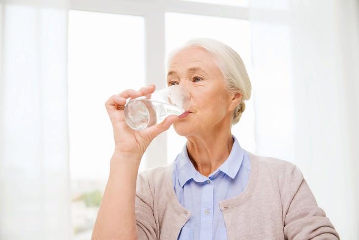 dehydration in seniors elderly woman drinking water