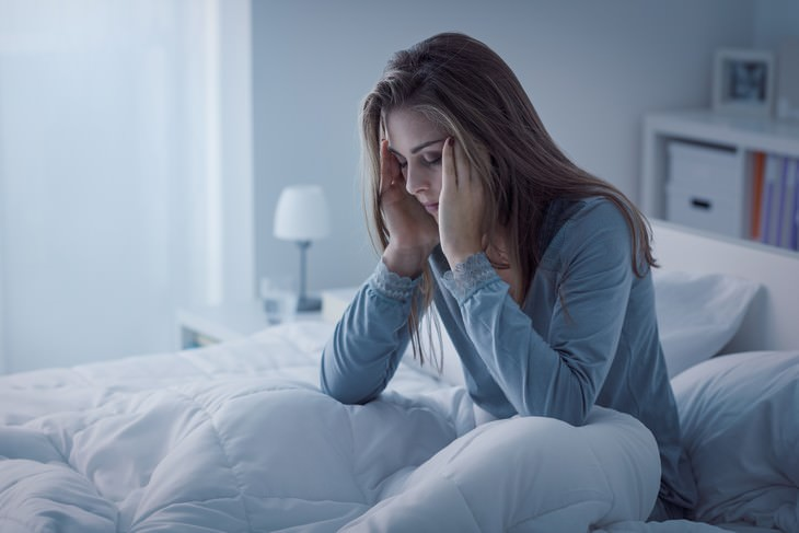 stress and insomnia woman having trouble sleeping